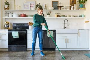 housekeeper sweeping kitchen